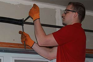 Garage Door Maintenance Adjusting Torsion Spring Tension