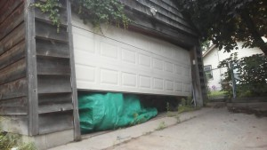 crooked garage door mpls